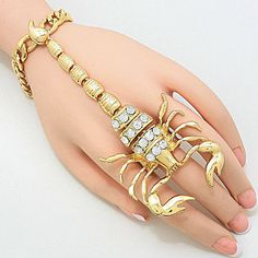 "New Women Fashion Halloween Gold Crystal Studded Scorpion Hand Chain Bracelet #halloween    • Bracelet Color : Gold / Clear  • Bracelet Size : 3/8"" H, 7"" + 2"" L  • Ring Size : 2"" H, Stretchable  • Line Size : 3"" L  • Studded Scorpion Hand Chain Bracelet  • Material : Lead and cadmium compliant"