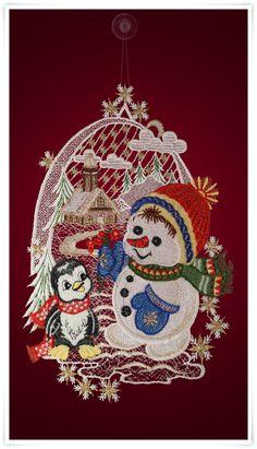 Fensterbild mit Schneemann und Pinguin