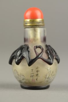 Chinese Peking glass snuff bottle, flanked with three conjoined Fu bats on the shoulder. Painted continuous scenes of scholar and rocks from inside. Signed Ding Er Zhong with one artist red seal.