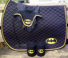 Custom Batman logo embroidery on the left side of a quilted Saddle Pad, set of fleece Polo Wraps (2) and a croched Fly Bonnet available in