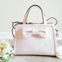 """SBWS! Kate Spade Dominique Murray St. Satchel Posy Superbowl Weekend Sale! 15% off 2, 20% off 3+ Sat & Sun ONLY! Just in time for Valentine's Day- The perfect spring pastel! A beautiful, NWT Kate Spade Dominique Murray Street pebbled leather satchel in a gorgeous shade of pale, """"posy pink."""" 14K gold- plated hardware, adorable (and iconic!) bow detailing, interior slip pockets, interior zip pocket, detachable shoulder strap and zip closure. Approx. 9"""" in height, 12"""" in length and 5"""" wide…"""