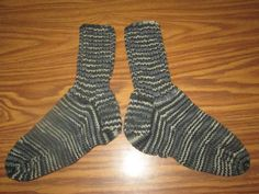Here is a wonderful pair of hand knit adult size socks. Heel to toe is approx. 9 1/2 in. and the ribbing on the top (top to ankle) is approx. 7 in. The yarn color is called Urban Camo. These socks are made of 100% acrylic yarn and can be machine washed and dried.