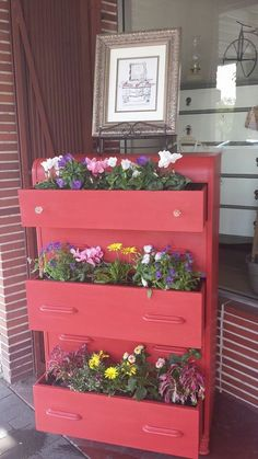 Vintage 1940's Waterfall dresser repurposed into a planter box (for in front of my store).