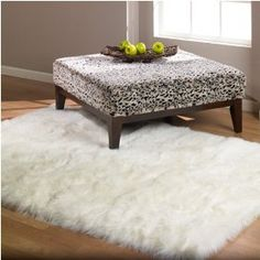 Flokati rug for living room with cream sofa and chair on dark wood floor
