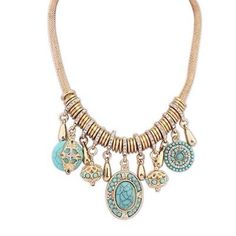 Turquoise, gold and charms designer necklace. Gorgeous turquoise and gold accented and rhinestones all make up this necklace. Worn by the designer on Love it or List it. Jewelry Necklaces
