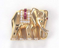 A GOLD ELEPHANT CLIP BROOCH, BY CARTIER   Enhanced by calibré-cut rubies, circular-cut diamonds and an emerald eye, with French assay mark for gold  Signed Cartier, no 683608