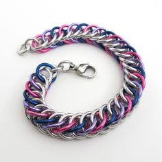 The vivid colors of the bi pride flag look striking in this chainmaille bracelet. Bold pink, beautiful purple and navy blue anodized aluminum jump rings are interwoven with shiny silver aluminum jump