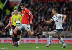 Manchester United's Spanish midfielder Ander Herrera runs away from Tottenham Hotspur's French midfielder Nabil Bentaleb during the English Premier League football match between Manchester United and Spurs