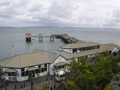 The Mumbles Pier is an 835 feet long Victorian pier built in 1898. It is located at the south-eastern corner of Swansea Bay near the village of Mumbles within the city and county of Swansea, Wales.
