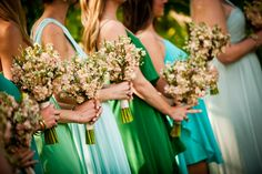 Maids in shades of blue, teal, and green.
