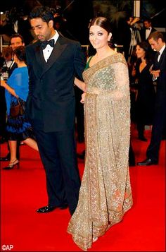 Aishwarya Rai Bachchan graces the red carpet with her fine beauty and designer saree.