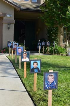 Graduation party ideas. School pictures decorate the yard and greet guests