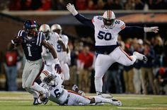 Laquon Treadwell of the Mississippi Rebels makes a reception and attempts to elude Jonathon Mincy of the Auburn Tigers at Vaught-Hemingway Stadium on November 2014 in Oxford, Mississippi. Laquon Treadwell, Oxford Mississippi, Auburn Tigers, November, Reception, Shoes, Fashion, November Born, Moda
