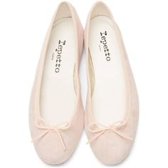 Supple goatskin suede ballerina flats in pale pink. Featuring a round toe, tonal grosgrain trim at the collar and bow detail at the toe. Details include tonal stitching around the shoe. Master cool parisian style in these versatile pastel pumps.
