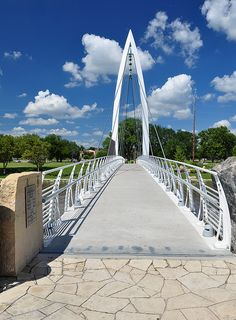Pedestrian Bridge - photo by G. O'Graffer, via Flickr;  The banks of Arkansas River and Little Arkansas River west of downtown Wichita, Kansas, are lined with a series of parks. They are interconnected by a number of attractive pedestrian bridges such as this one which was built in 2006.