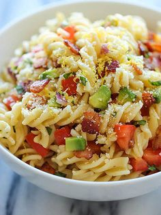 11 Pasta Salad Recipes You Need in Your Life this Summer | BACON & AVOCADO | The combination of avocado, crispy bacon, parmesan and a little chopped basil makes for one picnic-perfect dish.Get the recipe HERE.