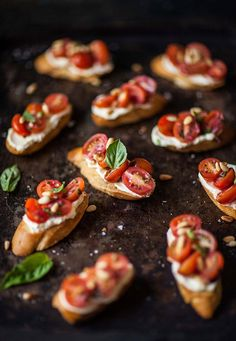 Tomato crostini with whipped goats cheese | DrizzleandDip.com #recipe #vegetarian #party