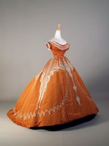 1864-66. Charles Frederick Worth ball gown of Orange silk with raised patterns in white silk,