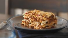 Simply Lasagna~My absolute favorite go to weeknight lasagna recipe which can be prepared ahead of time. I substitute italian sausage for the ground beef.
