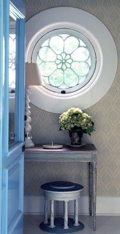 round window with flower design