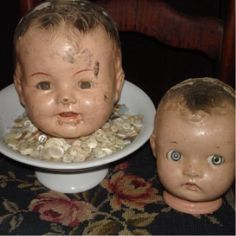 I've got a weird attraction to doll heads.  And white buttons.