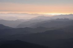 Mountain Layers Layers of mountains create a gradient of tones on ...