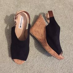 Black and brown faux cork wedges Black with brown strap, peep toe sling back faux cork wedges. Super cute and comfortable. Heel height is approx 4 inches but because the toe is raised about an inch it's more like a 3 inch heel height. Only worn twice American Eagle by Payless Shoes Wedges