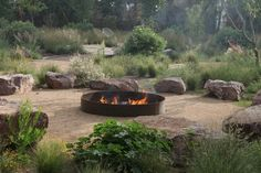 A fire feature turns a garden into a gathering place. A fire pit or fireplace is a lure because it creates warmth and light. And because of the hypnotic quality of flame and crackling wood.* fire pit The Capri Ten Eyck ; Simple Landscape Design, Desert Landscape, Contemporary Landscape, Australian Native Garden, Rustic Fire Pits, Fire Pit Designs, Low Maintenance Landscaping, Diy Fire Pit, Fire Pit Logs
