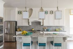 House of Turquoise: Traci Connell Interiors This is a nice color combo - gray tile and counter, cream cabinets, turquoise accents