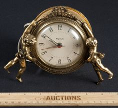 VINTAGE GOLD TONE ELECTRIC ALARM CLOCK BY STYLEBUILT . IT HAS TWO CHERUBS ON EITHER SIDE OF CLOCK. VERY SWEET PIECE.