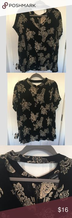 Torrid Damask Patterned Choker Tunic Top A gorgeous, super flowy tunic top from Torrid! Features a black, damask like floral pattern and a mock-choker like neck line! Top is long in both the front and back and covers the butt very well ;) Only worn once, and in excellent condition. Torrid size 1. torrid Tops Tunics