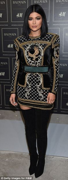 Model pose: Kylie showed off more of those thigh-high boots and heavily detailed dress at the show
