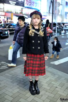 Yuki on the street in Harajuku wearing a Candy Stripper sailor jacket, a pompom beret, a resale plaid midi skirt, and One Spo chunky platform heels.