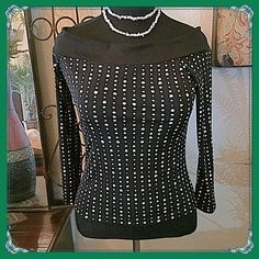 """White House Black Market Top Adorable black & white """"polka dot"""" top. The dots are more random circle designs that look like polka dots from a distance. Semi-fitted, raglan sleeves which can be pulled down to expose shoulders if you like or worn up. The sleeves are 3/4 length with open slits at the hem. Looks great with black jeans or skirt. Measurements: Bust =36"""", Shoulder span=approx.18-19"""", Shoulder to hem length=20"""". Poly knit. Size Lg. but fits more like an 8-10 in my opinion based on…"""