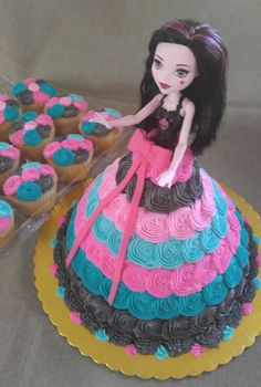 Monster High Doll Cake with Coordinating Cupcakes.  www.VintageBakery.com  (803) 386-8806.                                                                                                                                                                                 More
