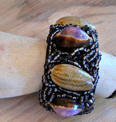 DBANE SEED 03  cowrie shells and glass seed beads sewn onto crocheted raffia base ZAR 495