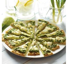 "Mozzarella and Goat Cheese Spring Pizza.a quick ""pesto"" made of arugula gives this pizza a peppery, fresh taste. Great Recipes, Favorite Recipes, Vegetarian Recipes, Cooking Recipes, Pesto Pizza, Healthy Choices, Main Dishes, Food And Drink, Healthy Eating"