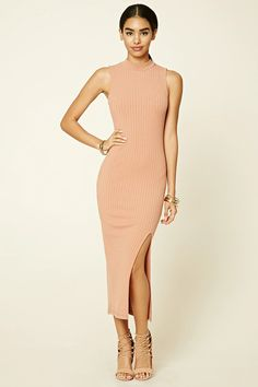 A sleeveless ribbed knit midi dress featuring a fitted silhouette, high neckline, and a skirt side slit.