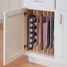 Kitchen Cabinet Organizers: DIY Dividers Adjustable slots organize cookware for space-efficient storage. Kitchen Cabinet Organizers: DIY Dividers Adjustable slots organize cookware for space-efficient storage. Kitchen Cabinet Organization, Cabinet Organization Diy, Home Organization, Kitchen Design, Diy Kitchen Storage, Kitchen Renovation, Cabinets Organization, Diy Kitchen, Kitchen Cabinets