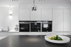 The sleek kitchen features Siemens appliances