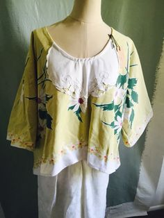 A personal favorite from my Etsy shop https://www.etsy.com/listing/234133248/vintage-floral-ooak-upcycled-xl-top