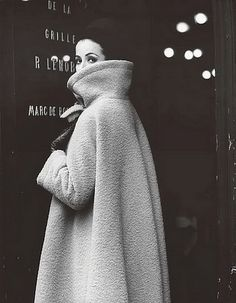 Gitta Schilling in a coat by Nina Ricci. Photographed by F.C. Gundlach, Paris 1962.