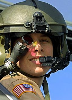 An unidentified female US Army captain posed inside an Apache combat helicopter at the army base at Bagram, Afghanistan, in 2003.