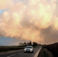 A storm at sunset closing in on the road to Strathaven, Lanarkshire, Scotland.