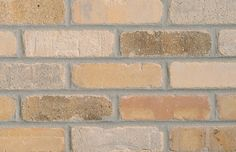 Unique to the reflection of your style, Cityhall thin brick offers a warm cream and toasted buff tones, with a slight burnished sandalwood. Its grey finishes will adorn any room with organic colors and textures. Fake Brick, Thin Brick, Brick And Stone, Brick Tiles, Brick Pavers, Brick Companies, Load Bearing Wall, Farmhouse Flooring, Stone Masonry