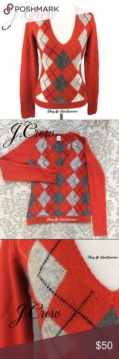 J. Crew cashmere, angora blend argyle sweater Pretty cashmere blend vneck sweater from J. Crew with gray argyle print on front. Color is a tomato orangish/red...perfect for Fall and to wear with denim. Great condition! If this is your first time shopping my closet, please read my 'about me & my closet listing, prior to any inquires. J. Crew Sweaters V-Necks