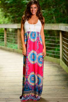 Oh-la-la! This maxi is so pretty! The vibrant print is amazing and the color combo is perfection! The soft solid top with the awesome, cool skirt is too good! You don't want to miss out on this number!