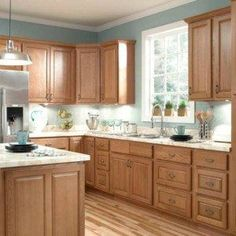 Elegant Honey Oak Kitchen Cabinets With Marble Countertop And Silver Refrigerator ,  Durable Oak Kitchen Cabinets In