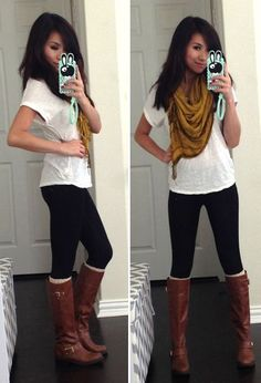 Shop this look for $26:  http://lookastic.com/women/looks/scarf-and-crew-neck-t-shirt-and-leggings-and-knee-high-boots-and-leg-warmers/3828  — Mustard Scarf  — White Crew-neck T-shirt  — Black Leggings  — Dark Brown Leather Knee High Boots  — White Leg Warmers