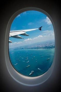 In flight view through an airplane window over singapore   photo by amar rai